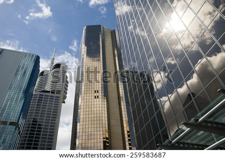 BRISBANE, QLD, AUSTRALIA - MARCH 17, 2014: perspective view to stee land glass high rise building skyscraper commercial modern city on riverside in Brisbane, QLD, Australia on March 17, 2014 - stock photo
