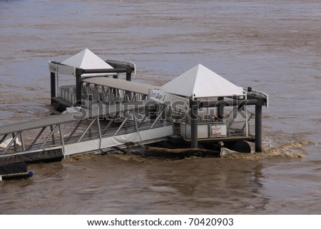 "BRISBANE, QUEENSLAND/AUSTRALIA - JANUARY 13: Destroyed City Cat pontoon ""North Quay"" on January 13, 2011 in CBD, Brisbane, Queensland, Australia. - stock photo"
