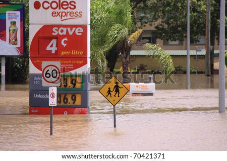 BRISBANE, QUEENSLAND/AUSTRALIA - JANUARY 13: Flooded gas station  on January 13, 2011 in Toowong, Brisbane, Queensland, Australia. - stock photo