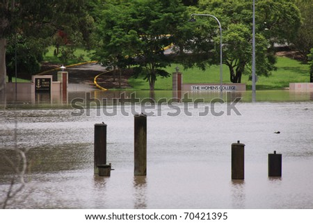 BRISBANE, QUEENSLAND/AUSTRALIA - JANUARY 13: Flooded park in Queensland University on January 13, 2011 in St Lucia, Brisbane, Queensland, Australia. - stock photo