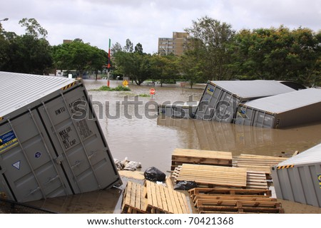 BRISBANE, QUEENSLAND/AUSTRALIA - JANUARY 13: Flooded shipping container park on January 13, 2011 in St Lucia, Brisbane, Queensland, Australia. - stock photo