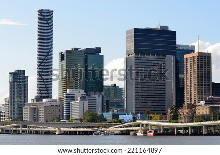 BRISBANE - SEP 24 2014: Skyscrapers in Brisbane.Until the 1970s the City Hall's 100-foot (30-meter) tower was the most prominent building, but it was later dwarfed by numerous commercial high rises. - stock photo