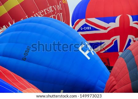 BRISTOL, ENGLAND - AUGUST 10: Balloons take off at the 6pm mass ascent at the Bristol International Balloon Fiesta, England, August 10, 2013 - stock photo