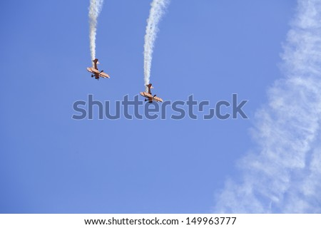 BRISTOL, ENGLAND - AUGUST 10: The Breitling wing walking display team perform at the Bristol International Balloon Fiesta, England, August 10, 2013  - stock photo
