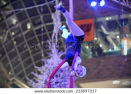 BRISTOL - NOV 7: An unidentified trapeze artist performs at Cabot Circus as the shopping mall officially opens for the Christmas holiday season on Nov 7, 2014 in Bristol, UK.  - stock photo