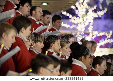 BRISTOL - NOV 7: Bristol Cathedral Choir peform in Cabot Circus shopping mall on Nov 7, 2014 in Bristol, UK. The choir peformed traditional Christmas carols for visitors to the mall.  - stock photo