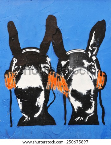 BRISTOL - NOV 8: View of a graffiti piece of donkeys with headphones by an unidentified artist on a city centre wall on Nov 8, 2010 in Bristol, UK. Bristol is famed for its graffiti and street art. - stock photo