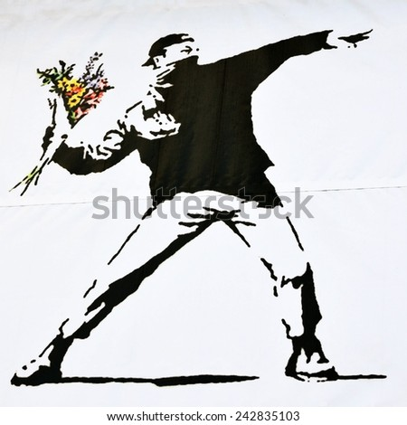 BRISTOL - OCT 19: Print of a famous Banksy graffiti piece promoting an art show at Elim Church on Oct 19, 2010 in Bristol, UK. Bristol is renowned for it's vibrant and political street art scene.  - stock photo