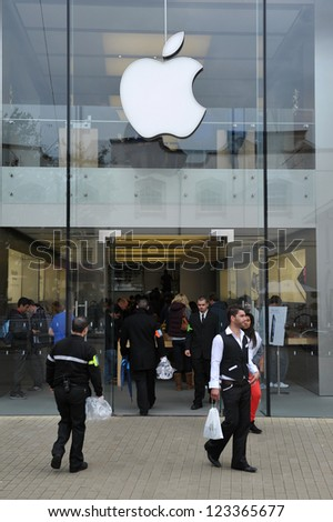 BRISTOL- SEPT 21: Shoppers enter an Apple store as the Iphone 5 is launched in the UK and Europe on Sept 21, 2012 in Bristol, UK. - stock photo