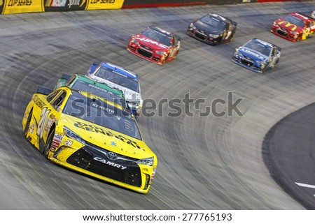 Bristol, TN - Apr 19, 2015:  Matt Kenseth (20) brings his race car through the turns during the Food City 500 race at the Bristol Motor Speedway in Bristol, TN. - stock photo