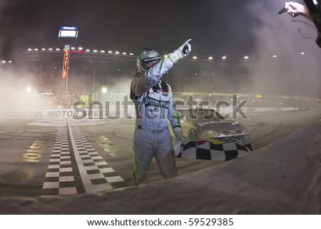 BRISTOL, TN - AUG 21:  Kyle Busch makes history winning all three races in a single weekend, winning the Irwin Tools Night Race race at the Bristol Motor Speedway in Bristol, TN on Aug 21, 2010. - stock photo