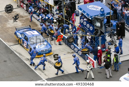 BRISTOL, TN - MAR 21: Kurt Busch brings his Miller Lite Dodge in for service during the running of the Food City 500 race at the Bristol Motor Speedway on Mar 21, 2010 in Bristol, TN. - stock photo