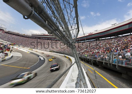 BRISTOL, TN - MAR 20:  The NASCAR Sprint Cup teams take to the track for the running of the Jeff Byrd 500 race at the Bristol Motor Speedway in Bristol, TN on Mar 20, 2011. - stock photo