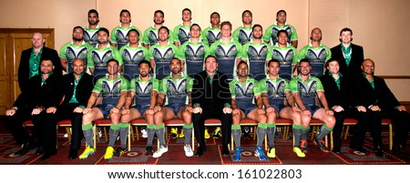 BRISTOL, UK - NOVEMBER 1 - The Cook Islands 2013 Rugby League World Cup Team pose for a team photo with their Coaches & Physios in a Bristol city centre hotel, Bristol, UK - November 1, 2013 - stock photo