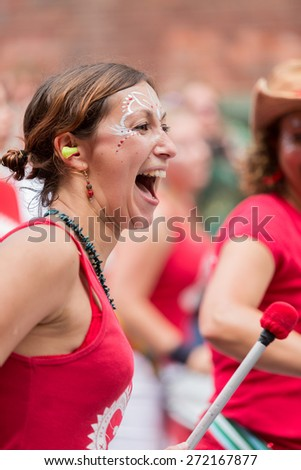 Bristol, UK. 5th July 2014. Drummer enjoying St. Paul's carnival - stock photo