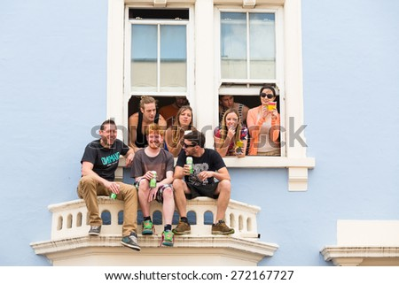 Bristol, UK. 5th July 2014. Group of onlookers get a great view of the parade from a first floor window - stock photo