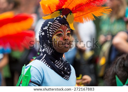 Bristol, UK. 5th July 2014. Many children from diverse ethnic backgrounds attend and perform in Bristol's St. Paul's Caribbean carnival - stock photo
