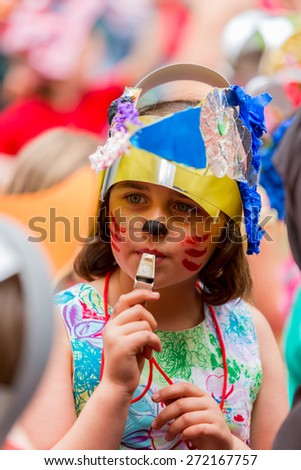 Bristol, UK. 5th July 2014. Young girl blowing a whistle at Bristol's St. Paul's carnival - stock photo