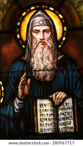 BRISTOW, VIRGINA - APRIL 26, 2015: Stained glass window depicting St. Benedict of Nursia holding the Rule of Benedict, located in chapel of St. Benedict Monastery - stock photo