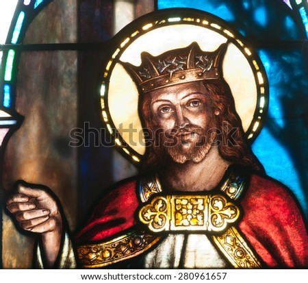 BRISTOW, VIRGINIA - APRIL 26, 2015: Detail of stained glass window depicting the Jesus Christ wearing crown and knocking on door, located in chapel of St. Benedict Monastery - stock photo