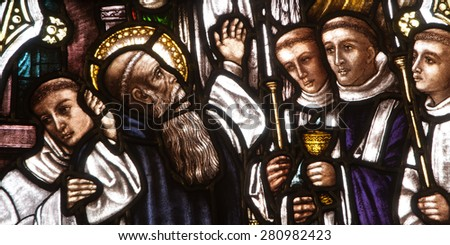 BRISTOW, VIRGINIA - APRIL 26, 2015: Stained glass window depicting death of St. Benedict surrounded by his monks, located in chapel of St. Benedict Monastery - stock photo