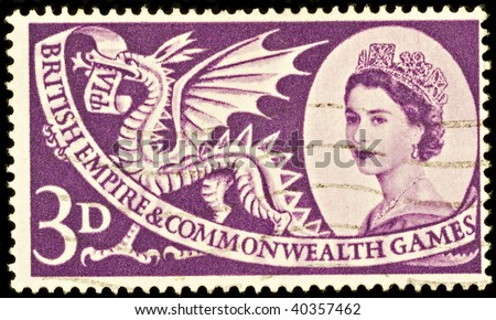 BRITAIN - CIRCA 1957: An old British three pence stamp celebrating the Commonwealth Games with portrait of Queen Elizabeth II, circa 1957 - stock photo