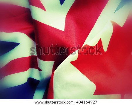 British and Canadian flags juxtaposed, filters applied - stock photo