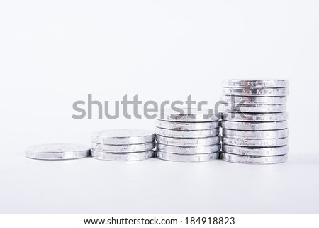 British coins arranged on a white background - stock photo