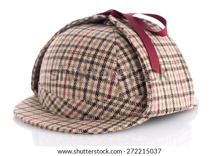 British Deerhunter or Sherlock Holmes cap on white background. - stock photo