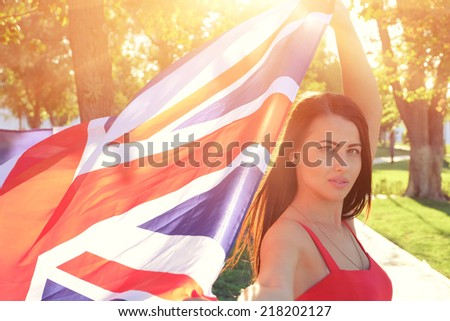 British girl holding the Jack Union flag in her hands - stock photo