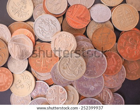 British Pounds coins of the United Kingdom - stock photo