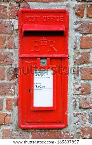 British Red Post Box set in brick wall - stock photo