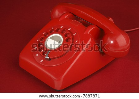 British retro red phone on a red background - stock photo