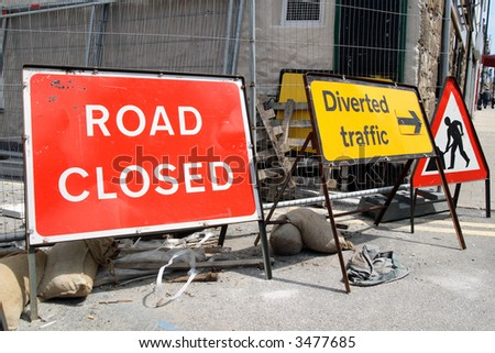 British roadworks with road closed and diverted traffic, signs. - stock photo