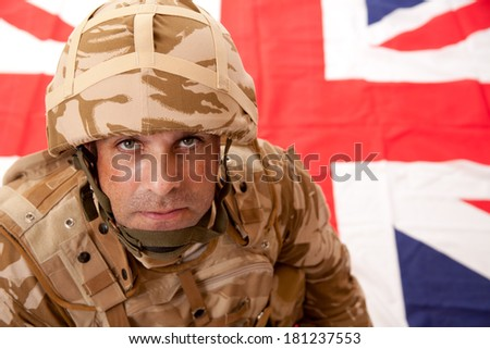 British Soldier With Union Jack Flag Background - stock photo