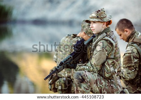 British special forces soldiers with weapon take part in military maneuver. war, army, technology and people concept. - stock photo