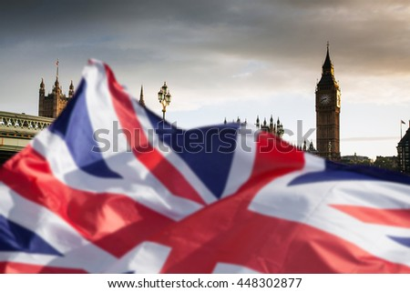 British union jack flag and Big Ben Clock Tower and Parliament house at city of westminster in the background - Brexit - stock photo