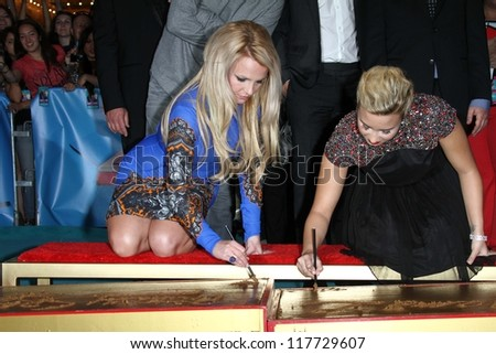 "Britney Spears, Demi Lovato at the ""The X Factor"" Season 2 Premiere and Handprint Ceremony, Chinese Theater, Hollywood, CA 09-11-12 - stock photo"