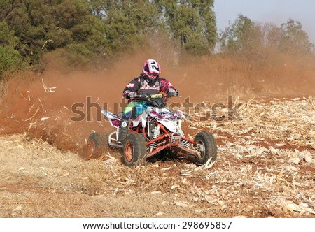BRITS, SOUTH AFRICA - July 11:  Africa-Offroad Racing Rally,  on July 11, 2015 at Koster, North West Province, South Africa.  Quad Bike kicking up trail of dust. - stock photo