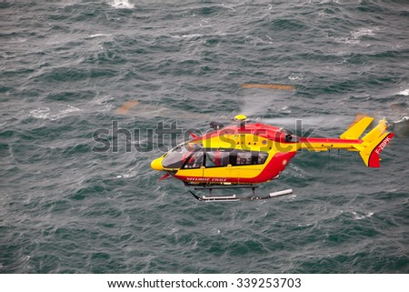 Brittany,France - September 27,2010: Search and rescue maneuver by Marine Rescue helicopter ,Bretagne,France - stock photo