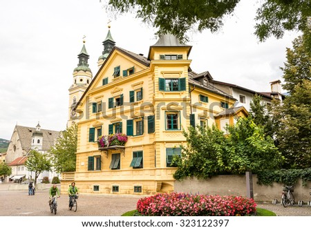 BRIXEN, ITALY - SEPTEMBER 22: Tourists at the Piazza Duomo in Brixen, Italy on September 22, 2015. Brixen is one of the oldest towns of Tyrol. Foto taken from Piazza Duomo with view to the cathedral. - stock photo