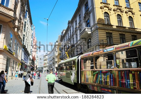BRNO, CZECH REPUBLIC - AUGUST 29, 2013: Locals walking on the downtown street  of Brno. Brno is the second largest city in the Czech Republic.  - stock photo