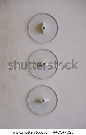 BRNO, CZECH REPUBLIC - CIRCA OCTOBER 2013: Unique light switches inside Villa Tugendhat, one of the masterpieces of modern architecture, designed by German architect Ludwig Mies van der Rohe. - stock photo