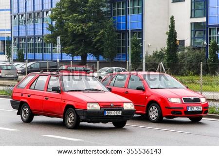 BRNO, CZECH REPUBLIC - JULY 22, 2014: Motor cars Skoda Felicia and Skoda Fabia at the city street. - stock photo