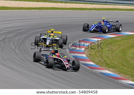 BRNO, CZECH REPUBLIC-JUNE 5: three cars from Formula Renault 3.5 Series in the World Series by Renault June 5, 2010 in Brno, Czech republic - stock photo