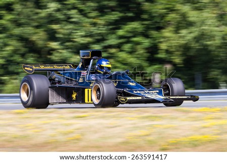 BRNO - JULY 4: Andrew Beaumont with his historic formula one Lotus 76/1, formerly driven by Ronnie Peterson, at the Brno Grand Prix Revival on July 4, 2014 in Brno, Czech Republic. - stock photo