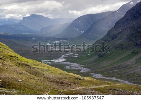 Broad Valley with the footpath of the Kungsleden trail in northern Sweden - stock photo