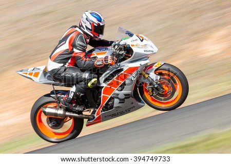 BROADFORD, VICTORIA/AUSTRALIA - MARCH 20: A mix of bikes and sidecars tussle against each other at Round 1 of the Interclub Series at The Broadford Motorcycle Complex near Melbourne. - stock photo