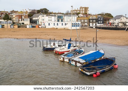 BROADSTAIRS, UK - JAN 7, 2015. Fishing boats in Viking Bay. Bleak House can be seen in the background. It has been asserted that it is the Bleak House referred to in Dickens' 1853 novel.  - stock photo