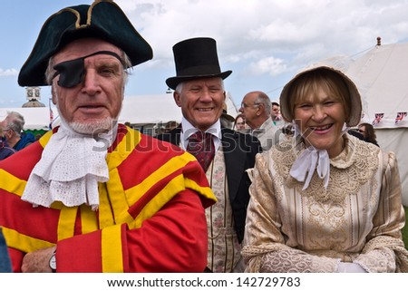 BROADSTAIRS, UK-JUNE15:  Unidentified members of the Dickens Festival. This annual event celebrates Charles Dickens connection to the town where he wrote David Copperfield. June15, 2013 Broadstairs UK - stock photo